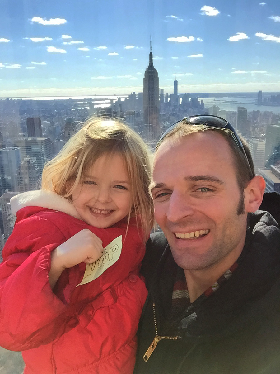 "Nothing but smiles showing off the ""Climb to the Top"" sketch with the Empire State building in the background."