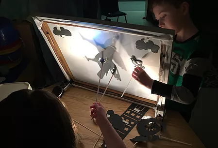 Students from Borland-Manor Elementary School exploring shadow puppetry in a Jumping Jack artist residency.