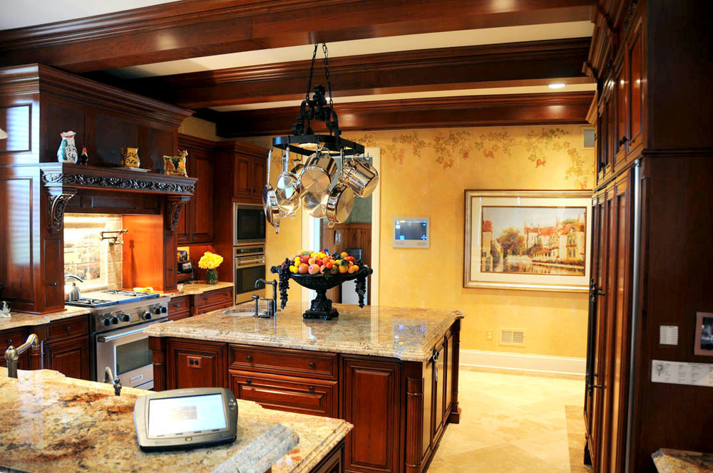 This gourmet kitchen features a large, in-wall Crestron touch panel at mudroom entry and handheld Crestron remote