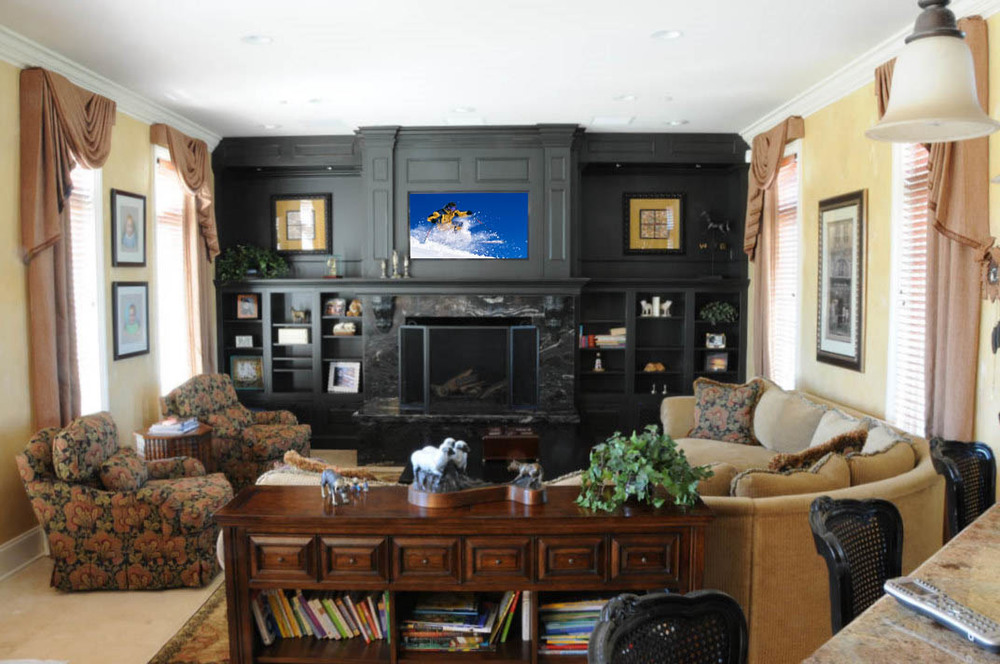 This living room's extensive custom cabinetry was designed to seamlessly integrate a large-panel TV