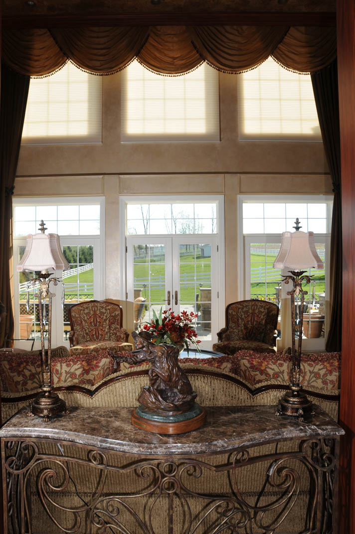 Twin sets of automated drapes control light and heat flow in this large great room