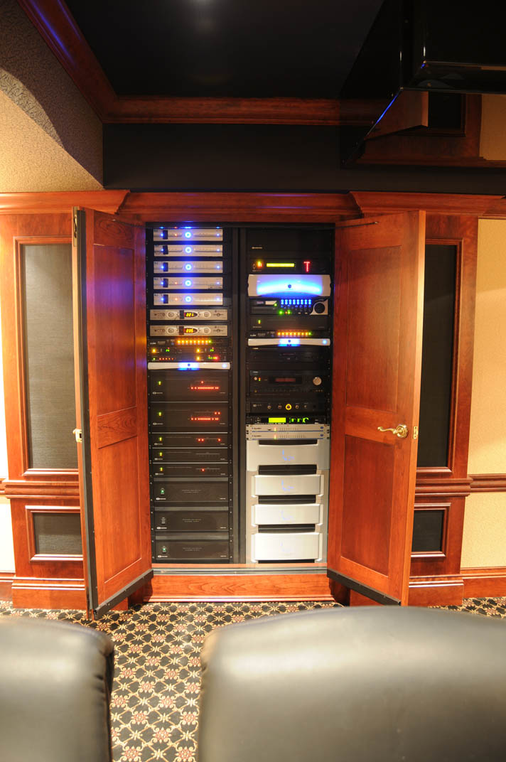 Theater rack containing all of the centrally distributed media sources and devices