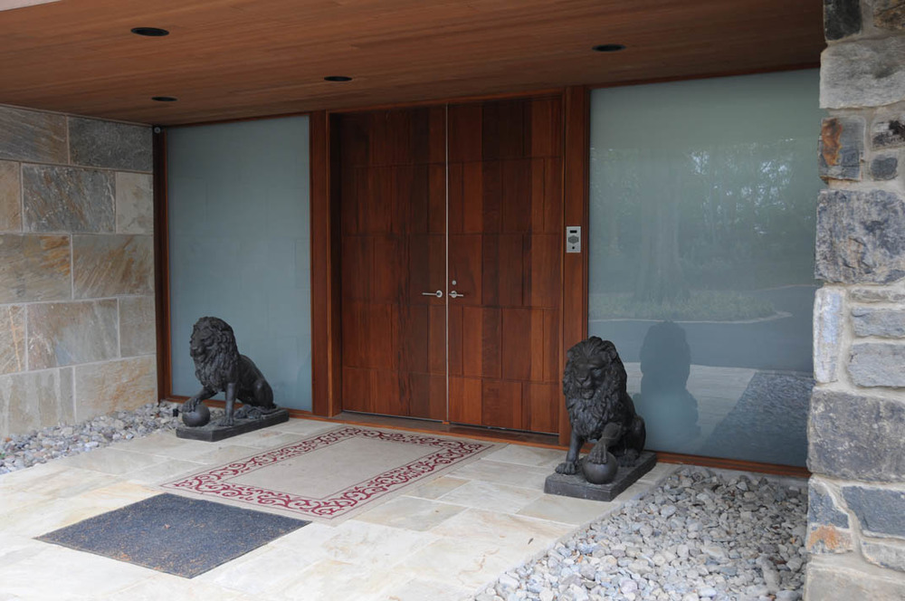 This large front entry has cameras and a two-way doorbell intercom system, accessible throughout the house.