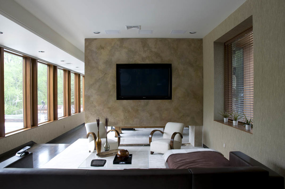 Media room with surround sound and a premium HDTV. Automated shades down this entire hall are controlled by the main automation system.