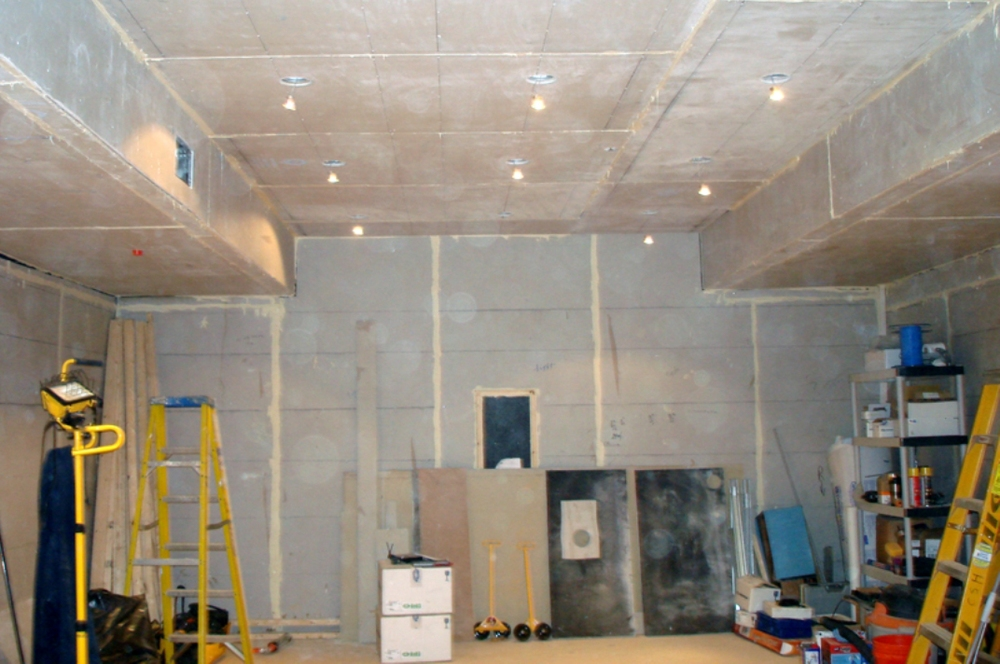 The same view with additional Quietrock in place. Metal sheets between layers of gypsum and a high-density vinyl membrane work in unison to keep sound within the theater