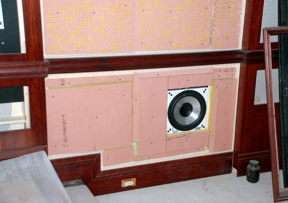 A field-balancing sub-woofer sits in a side wall, its 6ft. tall enclosure buried behind the wall. When tuned properly, these woofers equalize the bass throughout the room