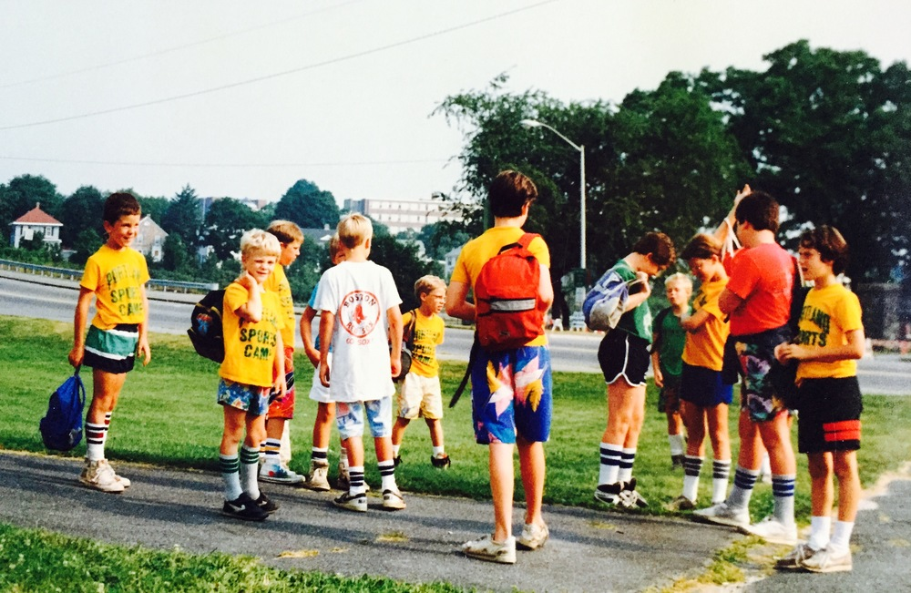 Campers eagerly await the bus for Kiwanis Pool in the summer of 1992.