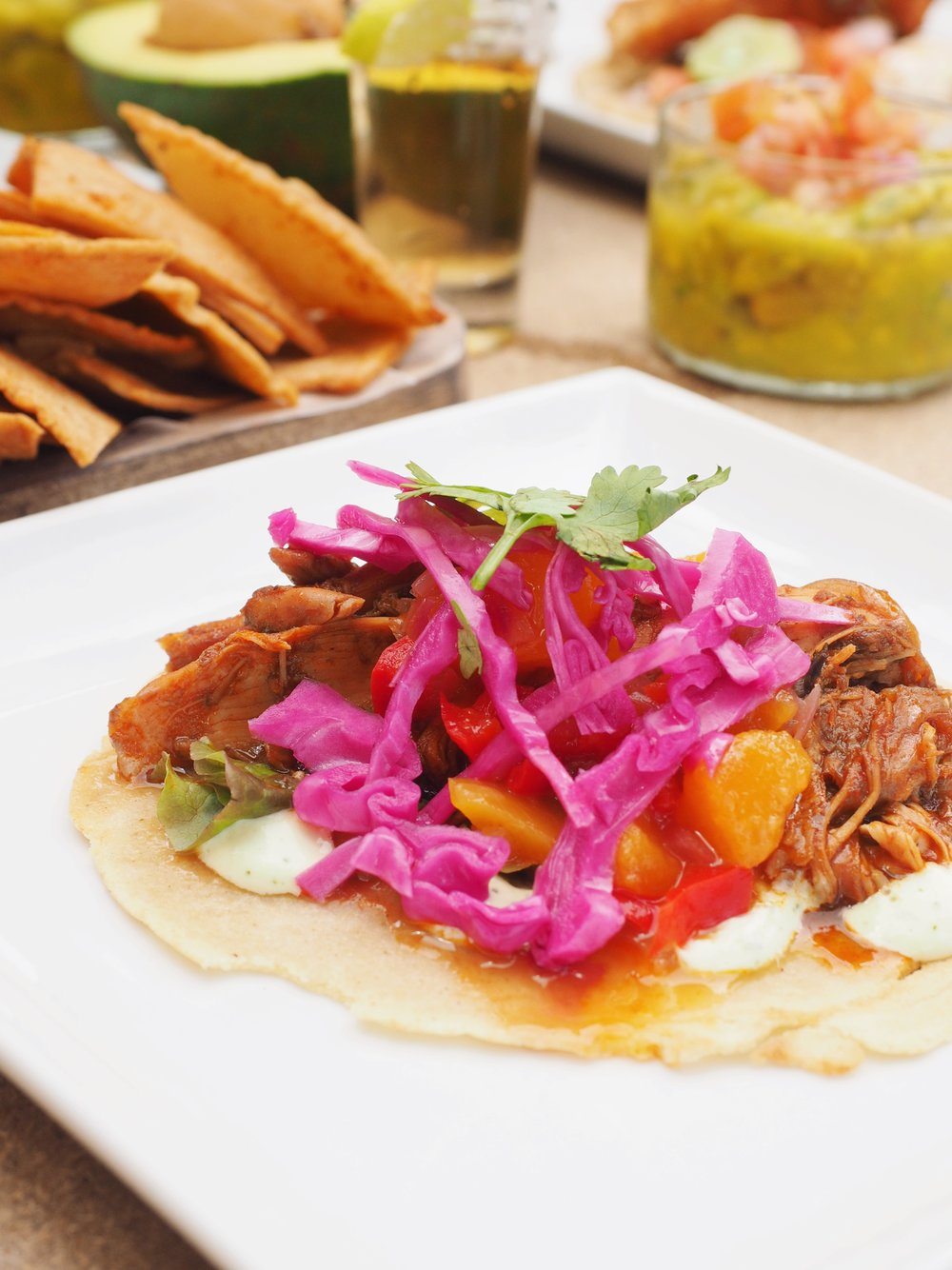 braise adobo chicken tacos with pickled slaw;