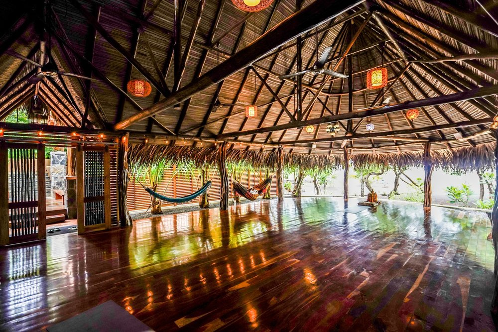 our oceanfront yoga shala is home to the first international, 10,000 BUDDHAS mural; and featured by  Architectural Digest  as one of the most stunning yoga retreats around the world.