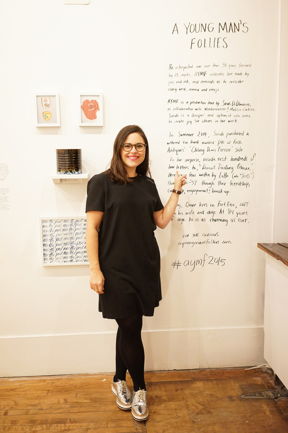Lead creative director Sarah Di Domenico stands with the show statement. Sarah's hand wrote all artist statements and bios on the walls of the gallery. Sharpie forever!