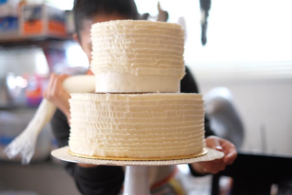2-tier wedding cake with buttercream ruffles