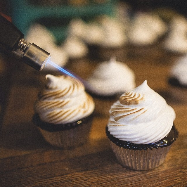 "Happy National S'mores Day!! Here's a shot of our ""Camp Out"" cupcakes getting a little toasty–captured by the very talented @msison #artisan #chocolate #cupcakes #dessert #dessertporn #foodie #foodporn #handmade #instahub #igers #la #laeats #losangeles #nom #noeycakes #sweettooth #igers_la #smores  (at NoeyCakes HQ)"