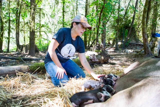 Janya of Redfeather Farm - yes, you can doula for your sow while wearing our tee!