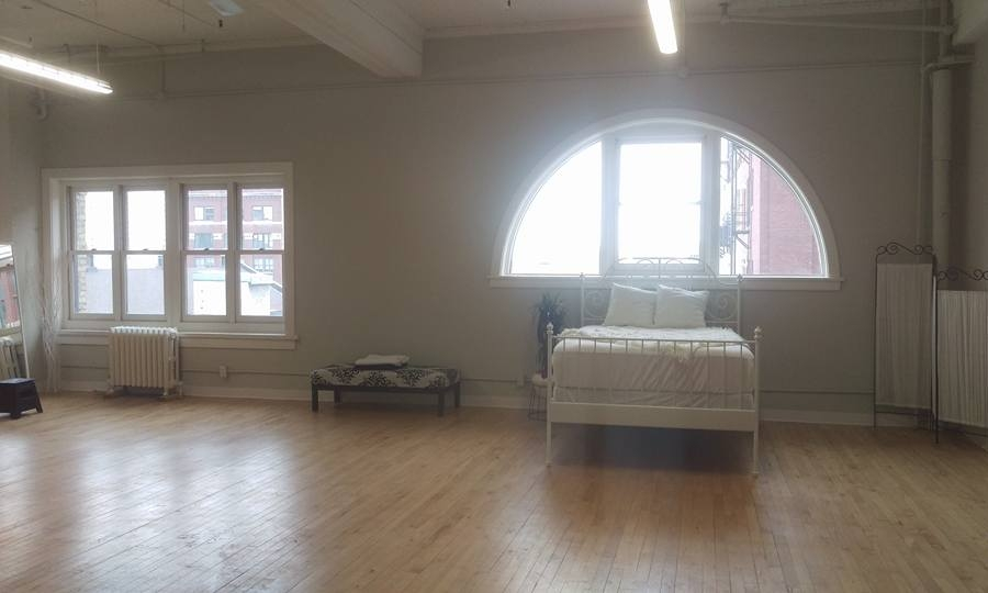 Primarily for boudoir photographs, the studio has a double bed.
