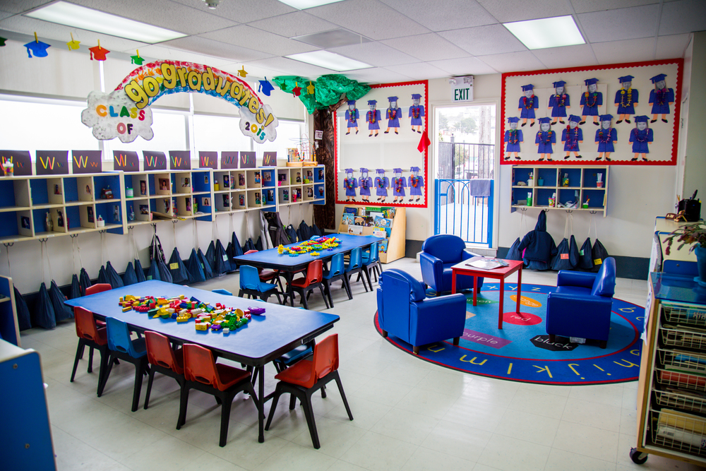 "One area of the ""Daisy Room"" - the smaller of our two classrooms at Little Star ""Too"" -  set up for morning play time with manipulative toys and library books."