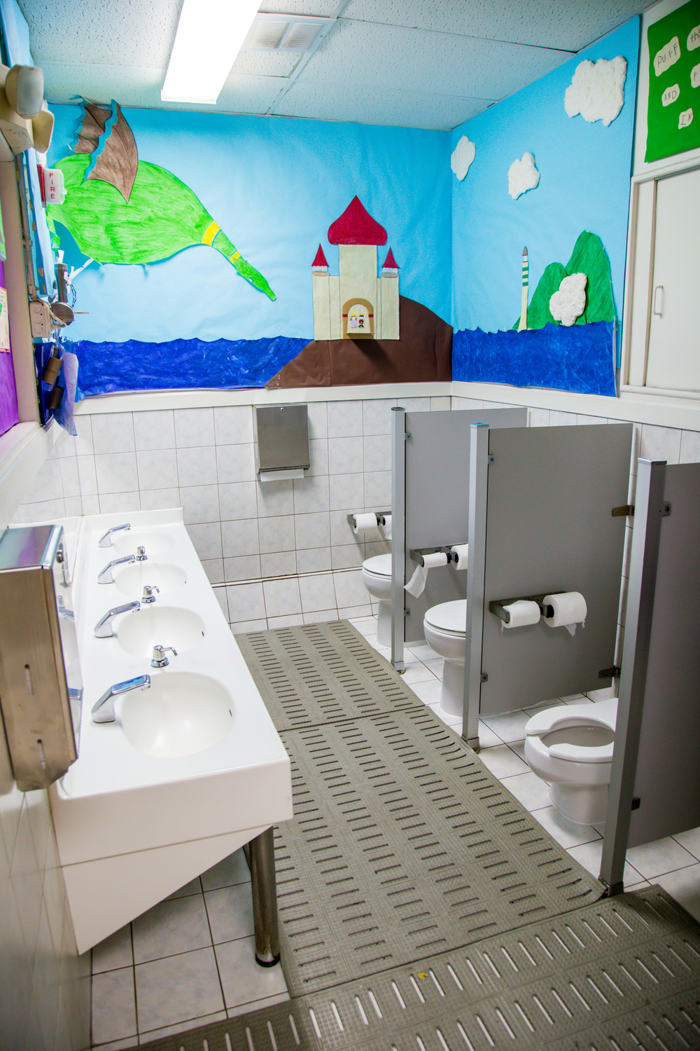 The Daisy Room's child-friendly bathroom, always decorated with colorful artwork.