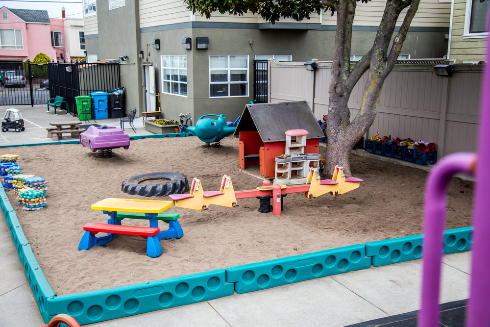 Our sandbox has several permanent structures within it: a small house, and airplane and car to climb in and ride, and a seesaw. From dinosaurs to shovels and pails, cups and sieves, tables and blocks, there's something for everyone!