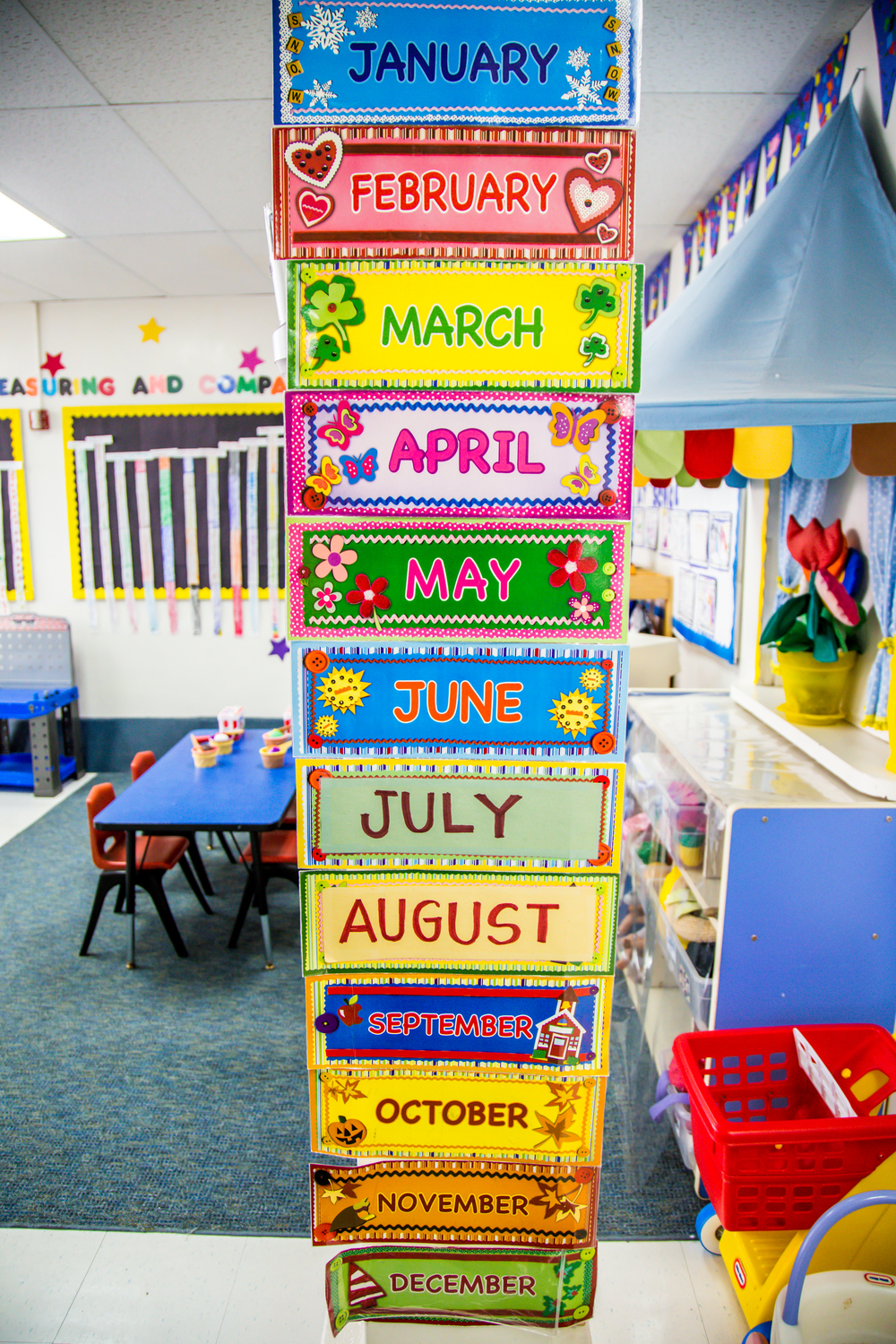 In the Daisy Room, children learn about months and days at calendar time in the morning.