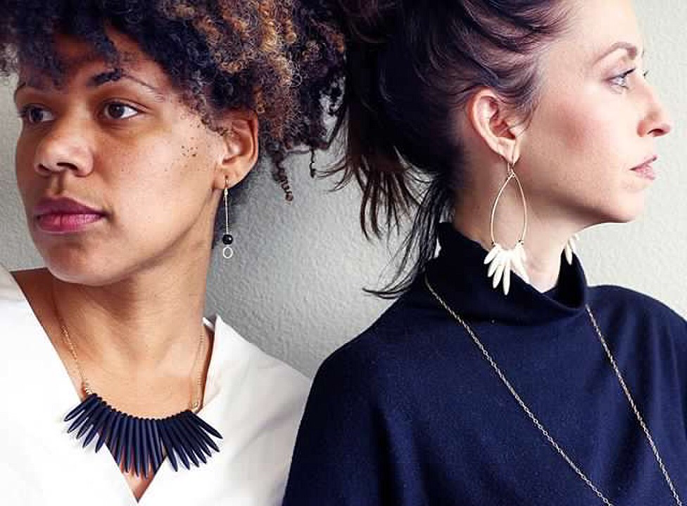 aleia wears onyx monostone earrings and black howlite statement necklace.  effie wears morning doves statement earrings.