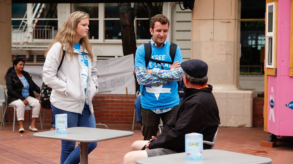 BPBC team members sharing the Gospel with a Portland man downtown in Pioneer Square.