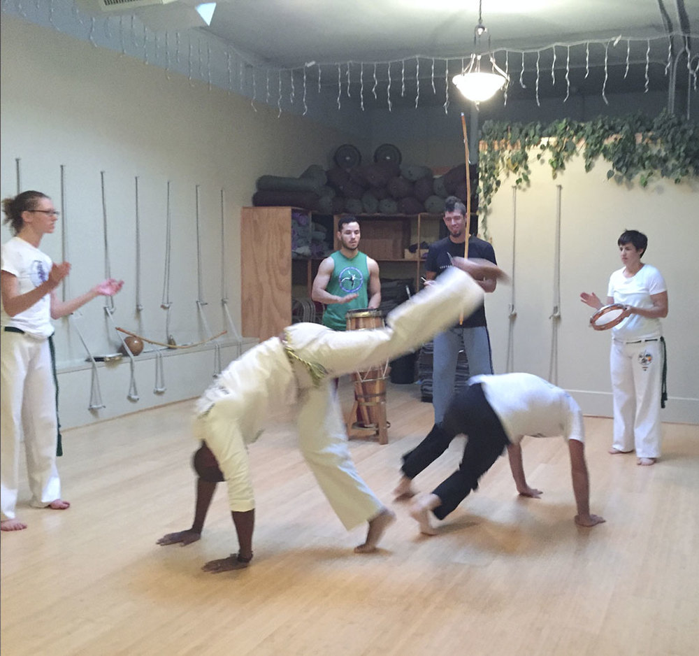 Students practicing Capoeira to music.