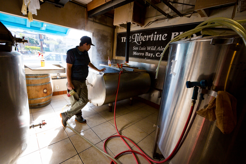 Libertine Pub Brewer/Owner Tyler Clark uses native yeast, chunks of Morro Rock, and a fly-by-the-seat-of-his-pants mentality to craft epic sour brews on the Central Coast.