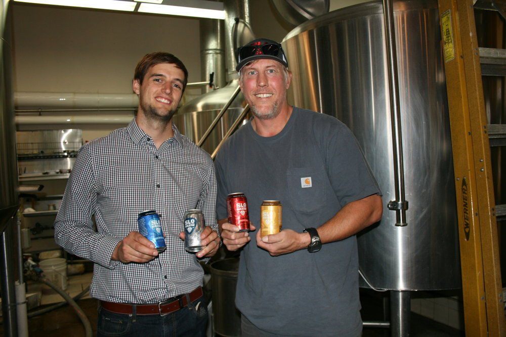 WE CAN DO IT   From left, SLO Brew Director of Marketing Brian Kerr and Brewmaster Steve Courier showcase their new 23-ounce cans.