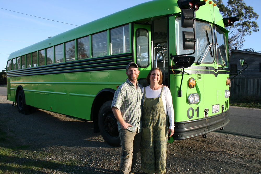 NEXT STOP, FRESH GREENS  Kara Strauss, founder and owner of Bloom Microgreens in Los Osos, is the proud owner of SLO County's first functioning mobile micro-farm. Pictured with the neon green school-bus-turned-micro-farm is her husband and biggest supporter, Adam, who found the green machine on Craigslist.