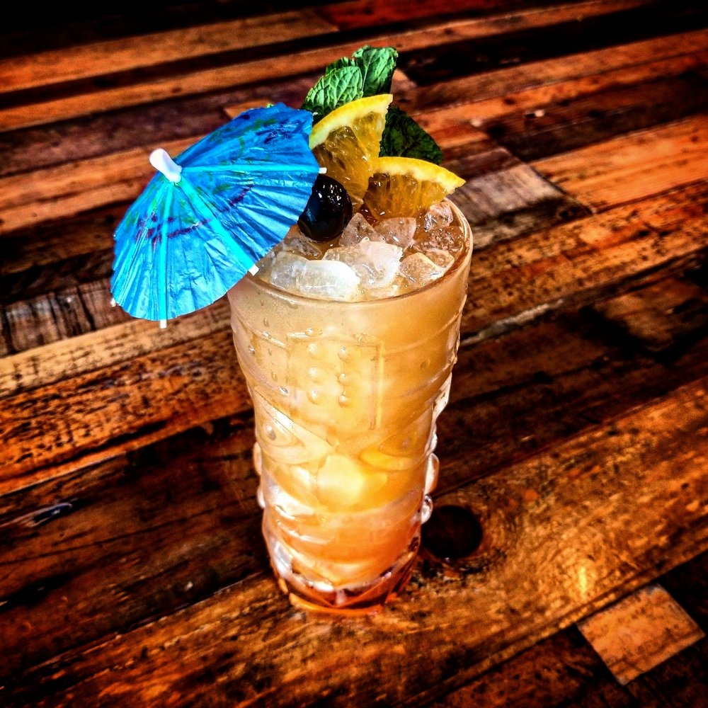 "SAVOR THE STING    A ""medium strength"" tiki drink, the Sidecar Cocktail Co. Scorpion is made with Banks 5 Island rum, Camus cognac, lemon, orange, and orgeat."