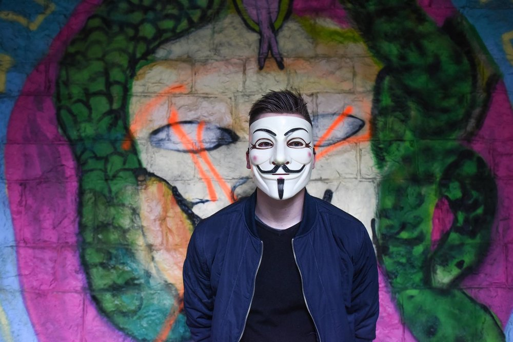 Your standard Guy Fawkes mask.