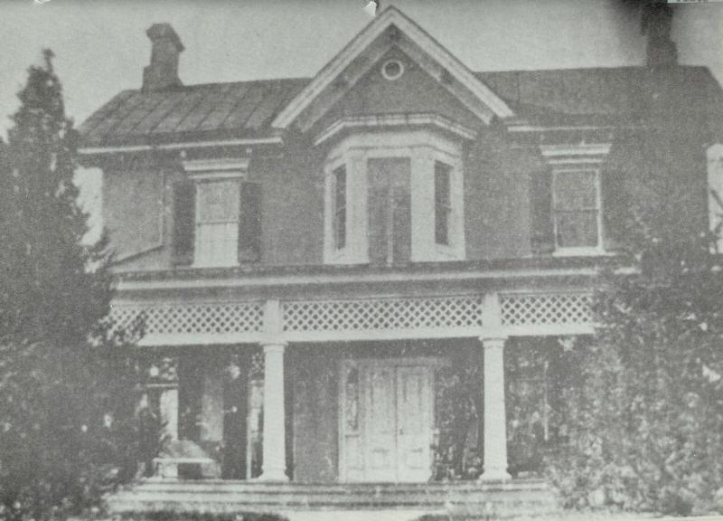 Front of Cedar Hill in the 1890's with Frederick Douglass visible in the shadows to the right of the door. Photo Credit: National Park Service