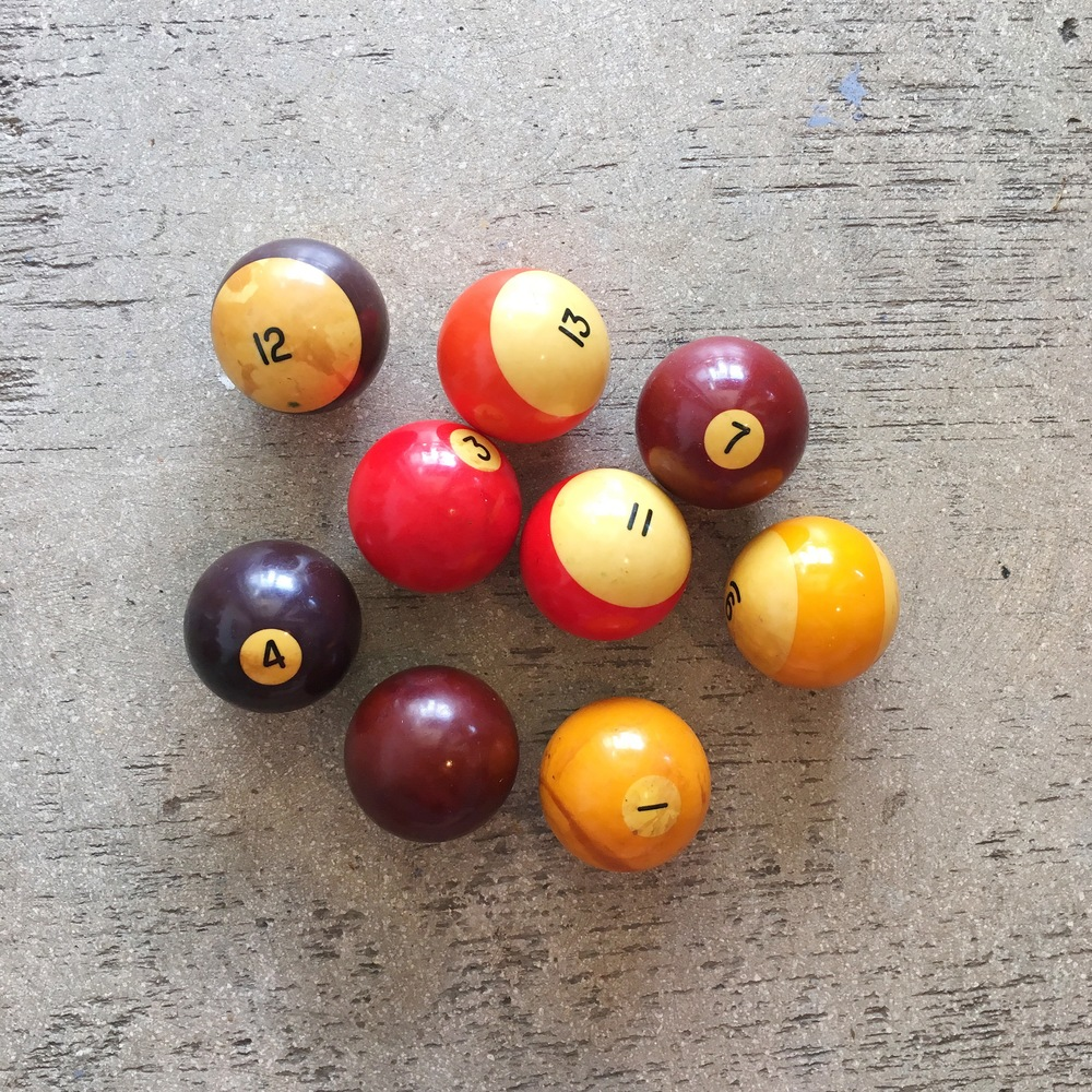 Who doesn't love a friendly game of pool? With these vintage pool balls displayed in a special bowl he'll have all his guy friends drooling as to where he found them! Plus, they add a nice pop of color and curiosity to any space! ($30.00 for the set of 9)