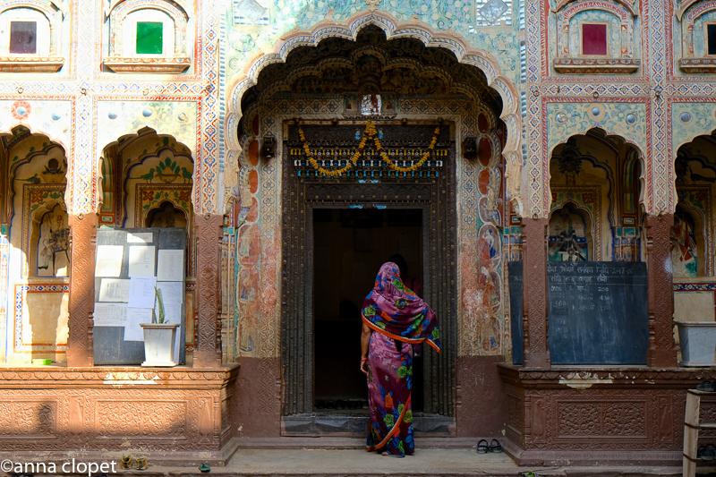 A women walks through to the inner courtyard in Nawalgarh