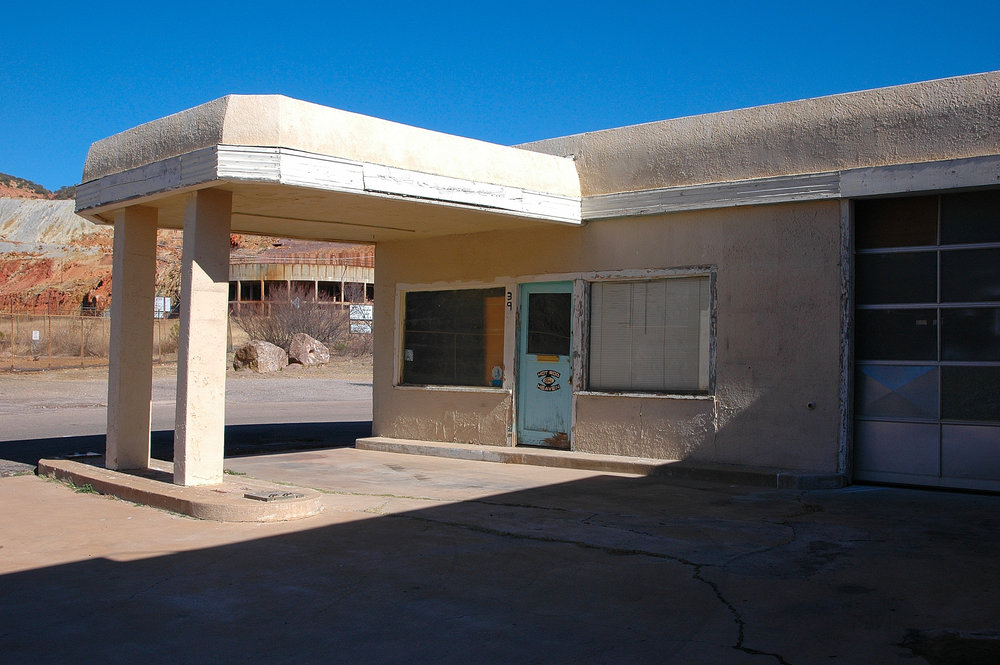 Abandoned gas station, although it appeared a hot rod business had operated here recently.