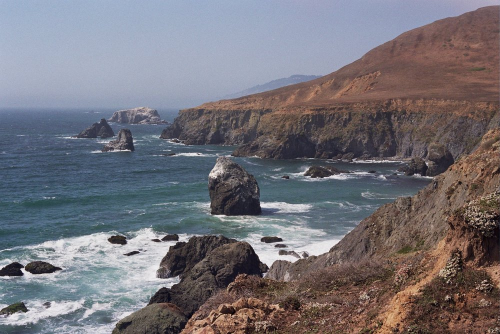 The trail winds close to the cliffs over the Pacific.