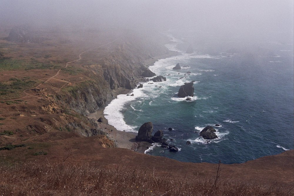 The marine layer is your constant companion along this trail.