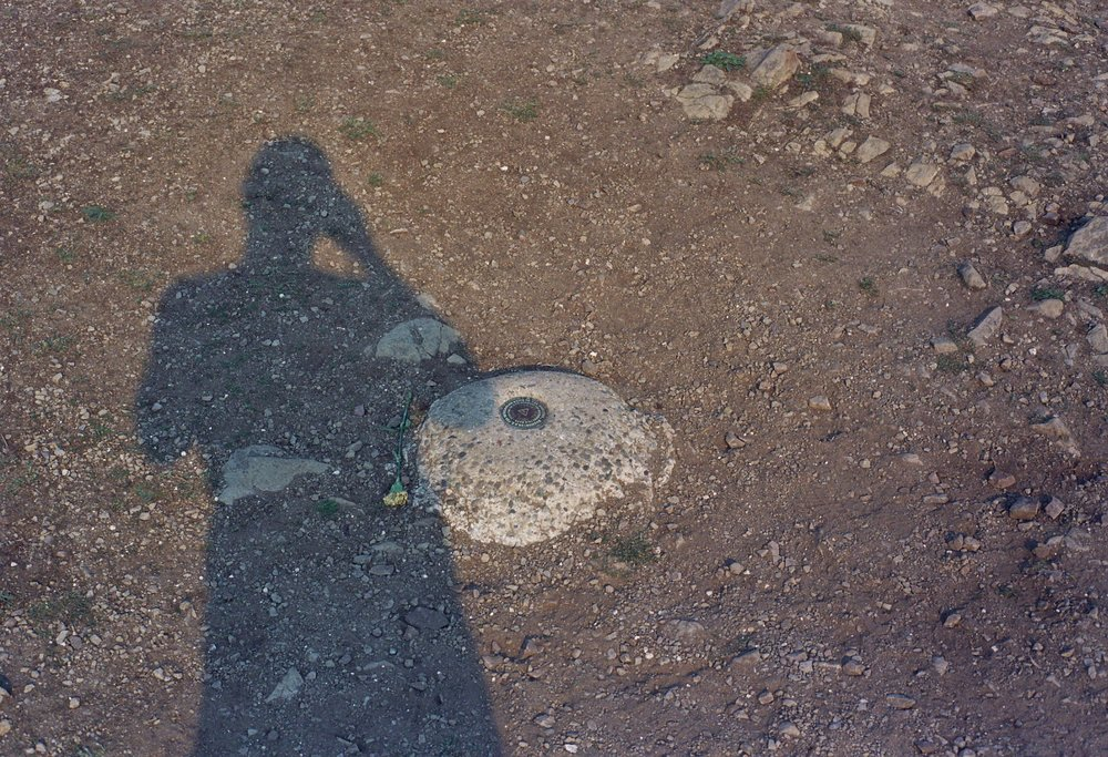 Geodetic marker shadow selfie