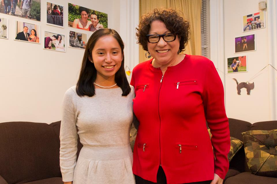 A student poses for a photo with Supreme Court Justice Sonia Sotomayor