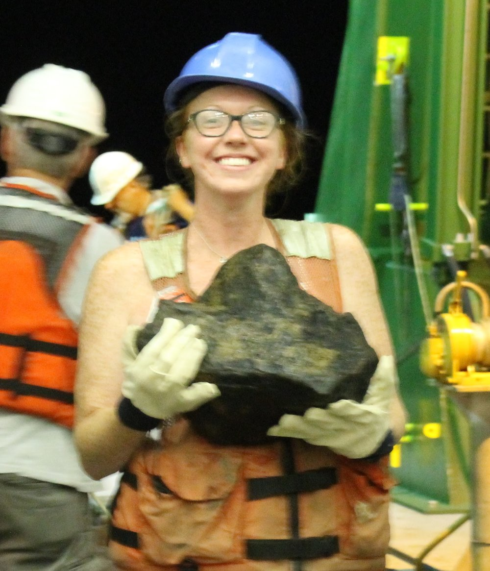 Holly Pettus - WVU senior Holly Pettus (class of 2018) worked with Dr. Ken Brown on megacrystic K-feldspars from Granite Peak Stock. She investigated the origin of the K-spars with petrography and geochemical analysis (microXRF and EMPA). Holly was a 2017-18 NASA Space Grant Scholar.This is Holly during her REU at the University of Hawaii in the summer of 2017. Holly is holding a dredged basalt clast from the ocean floor around Molokai.WVU Student Spotlight articleHolly is a native of Pineville, WV.