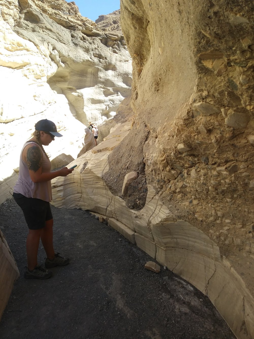 Shelby Isom examining scours in the Noonday Dolomite at Mosaic Canyon, Death Valley NP.
