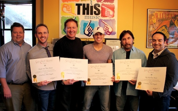 "Receiving ""Million-Air Awards"" from BMI-Nashville"