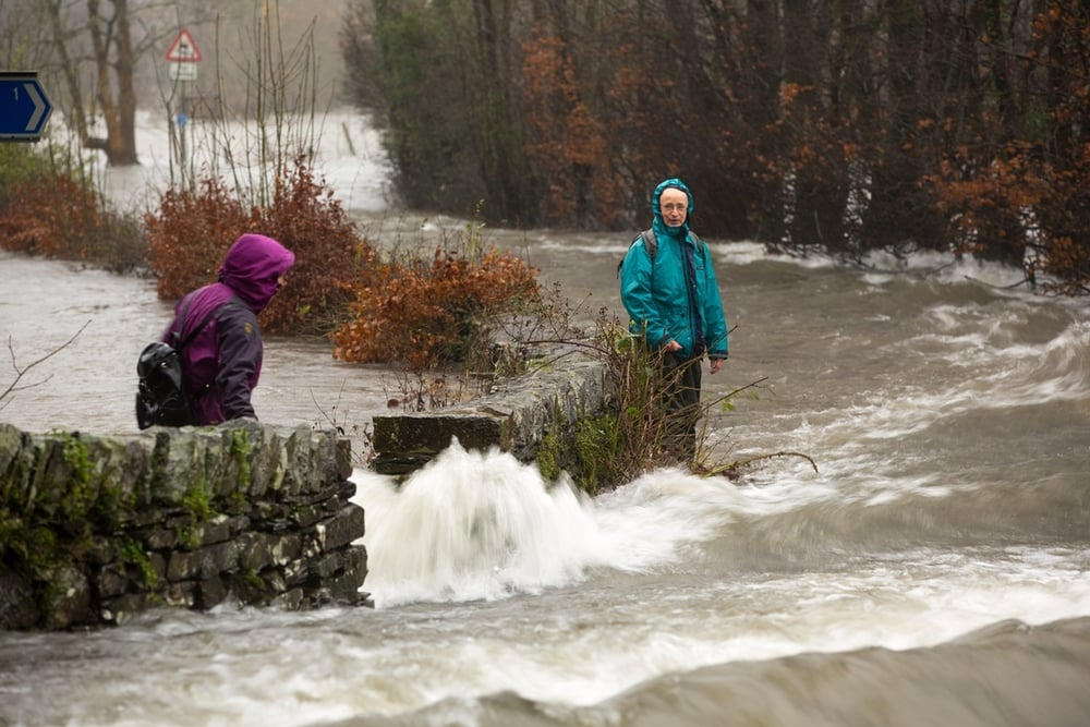 Walkers trying to cross raging floodwaters on the Ambleside to Coniston road at Rothay bridge Photograph: Ashley Cooper / Barcroft Media  http://www.theguardian.com/uk-news/gallery/2015/dec/05/storm-desmond-in-pictures