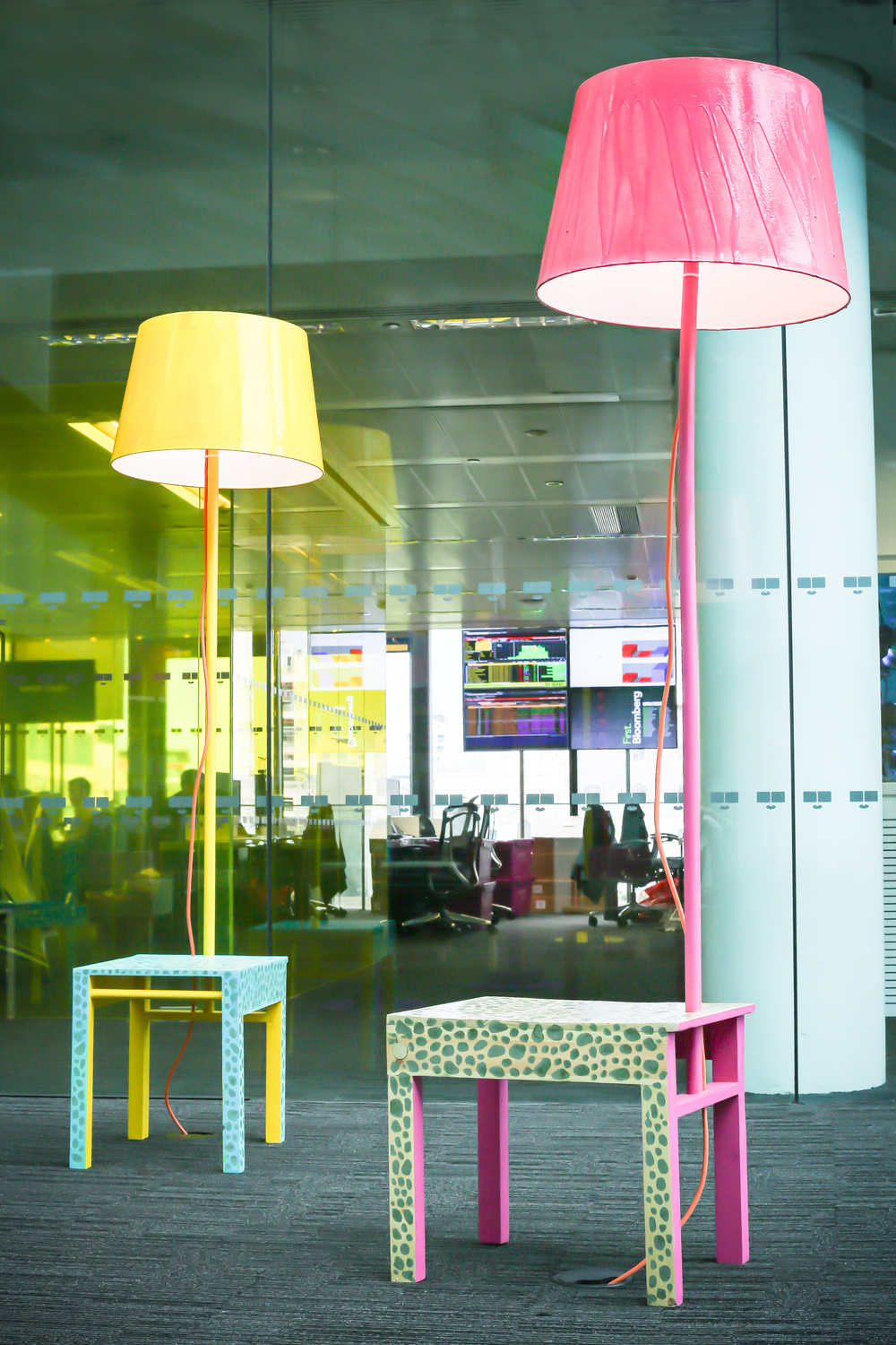ACID SAFARI for Bloomberg Waste Not Wanted 4, 2013 Lounge area installation of 20 furniture pieces for Bloomberg HQ, London. In ACID SAFARI Eelko Moorer confronts the office environment with an expressive outing of the personal and tactile. The installation consists of stools with arm rests, low tables and lights;  all of which are functional, but whose aesthetic language embodies a playful, tactile, somewhat absurd animalistic nature.  Moorer cites Atiz Rezistance, J-M Basquiat, Alchymia, and animism as influences.  The functional objects are enlivened by the patterns manually crafted into their surfaces, and the bright pigments dyed into them.  Screened furnishings are positioned in the middle of the room and on closer inspection reveal a specially commissioned repetitive hypnotic surface animation by Catherine Anyango providing a contemplative centre, or altar, to the installation environment. The work was realised using Bloomberg pallets, discarded computer screens and computers combined with a low-tech approach to making. A level of intricacy is added to the pieces through colourful inlay, patterns and dying. The dimensions of the pieces are as much as possible defined by the size of the pallets, using halves or doubles of this standard unit. The aim was to design different styles and functions of furniture together so to create odd typological hybrids resembling animalistic creatures.