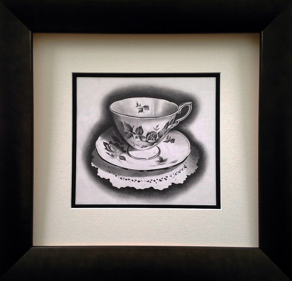 Teacup, pencil and paper