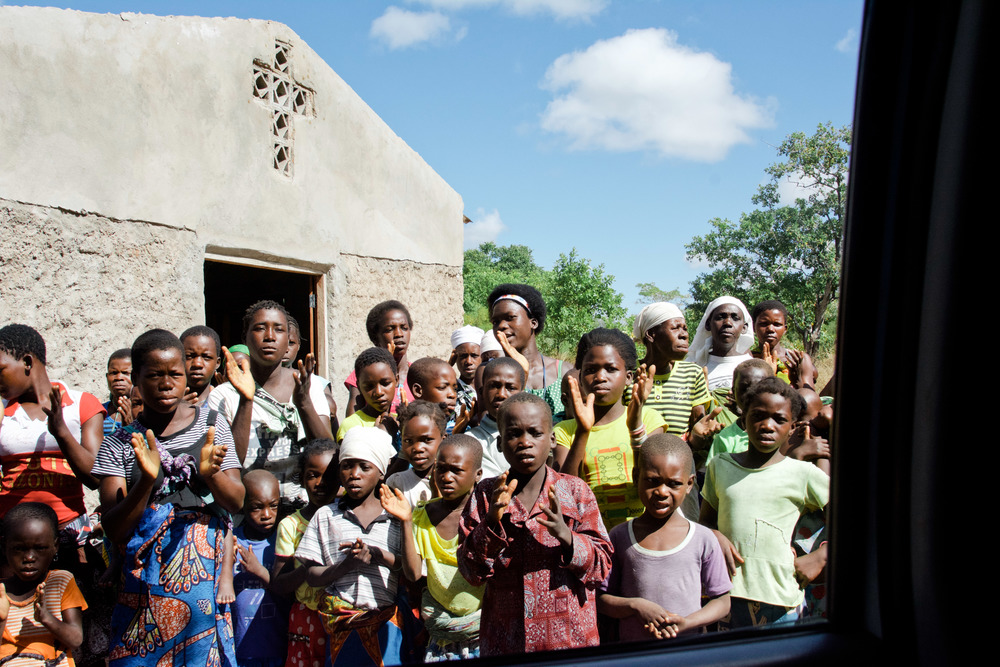 Most of the congregants are young women and children. Here, they are saying goodbye as we head to our next congregation.