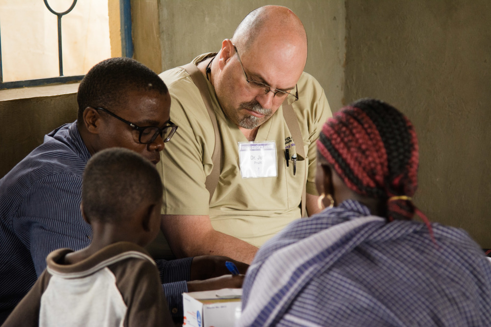 Dr. Jeff Pruitt from Ohio works with his Kenyan counterpart to treat a patient.
