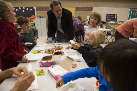 Youth make haunted houses out of sugar cubes while Governor Bullock looks on (Photo credit: Louise Johns, Bozeman Daily Chronicle)