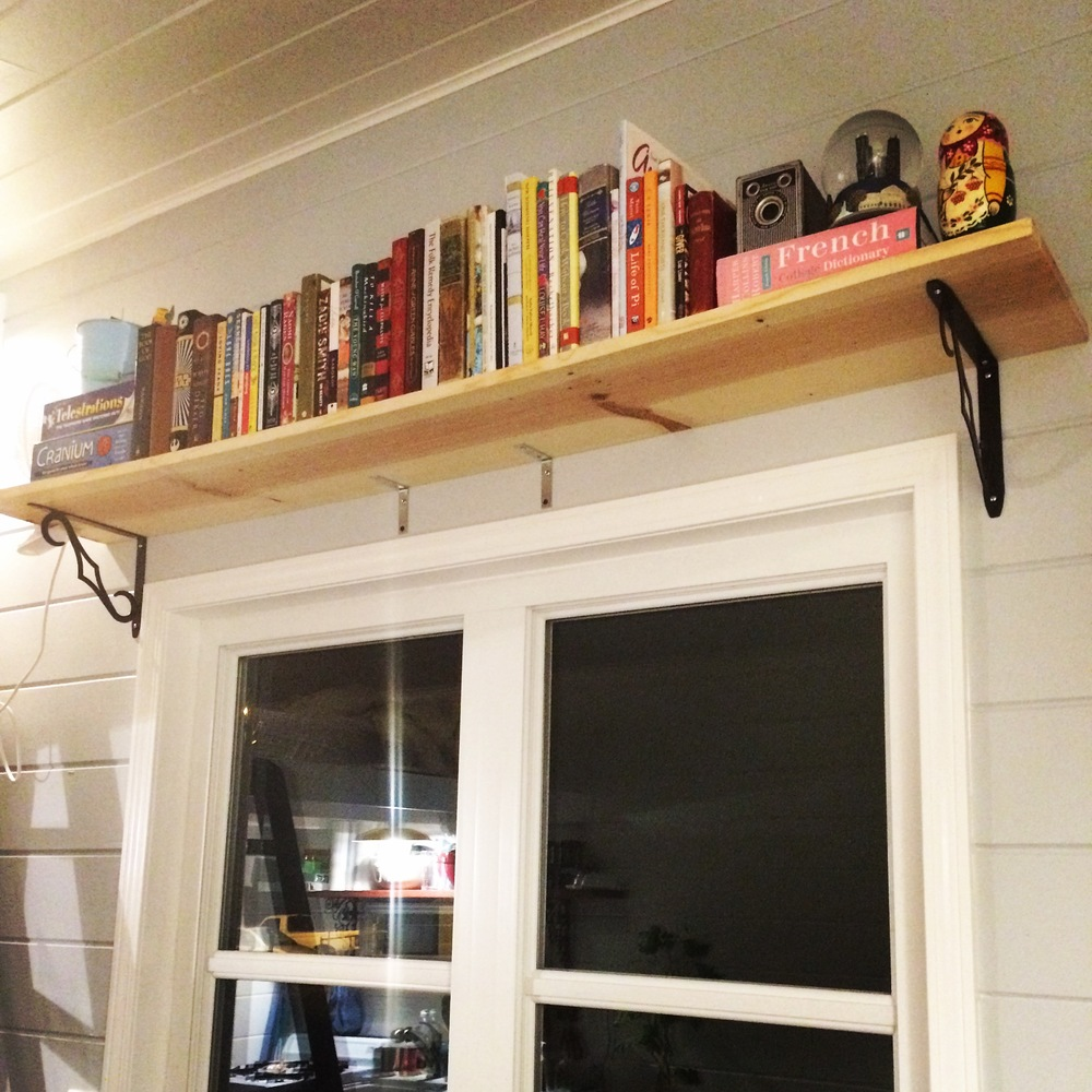 Our bookshelf above our large window in our living room.
