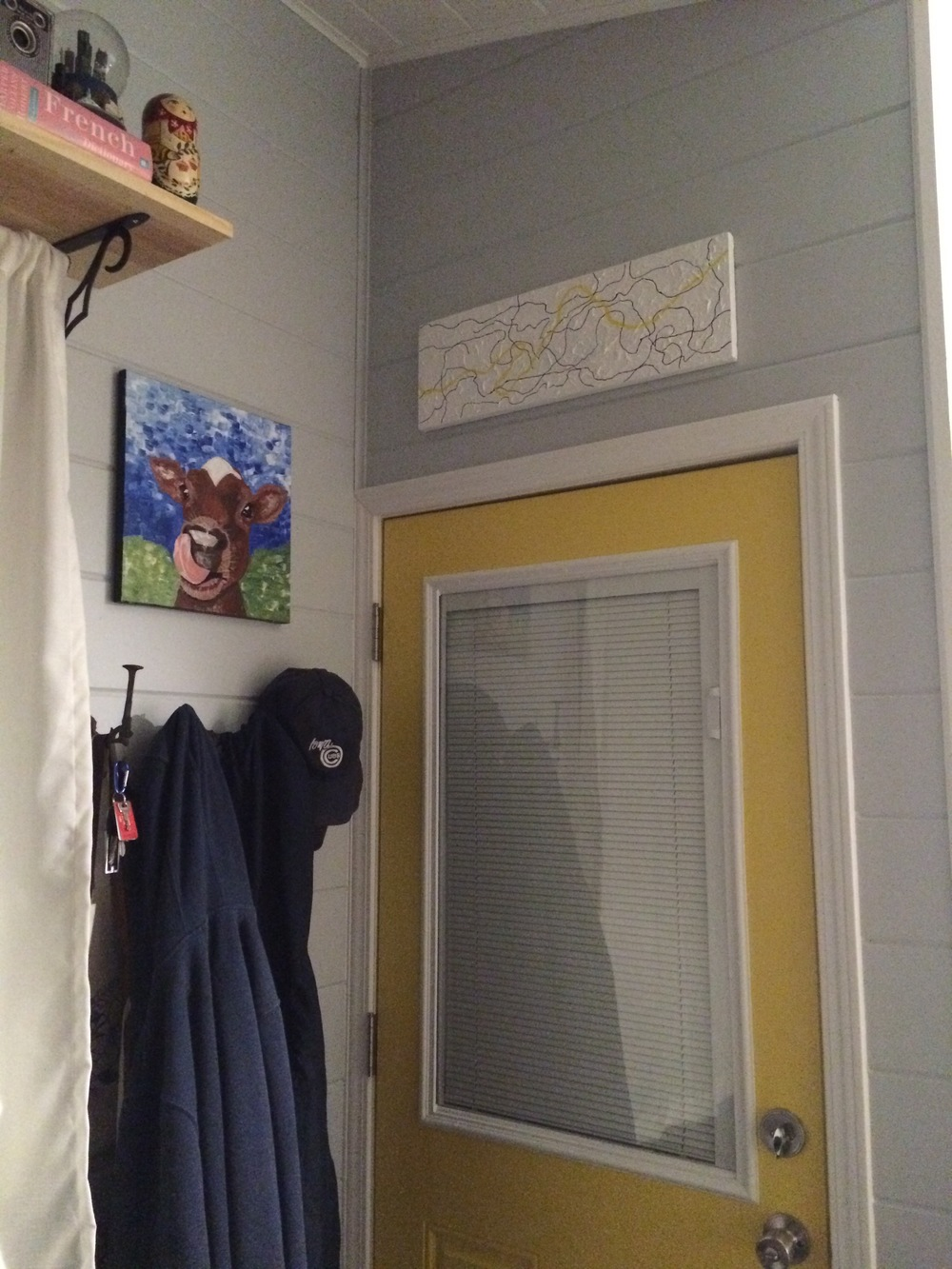 Our entryway. We have hooks for coats and hats and shoe storage that hangs on the wall beneath.