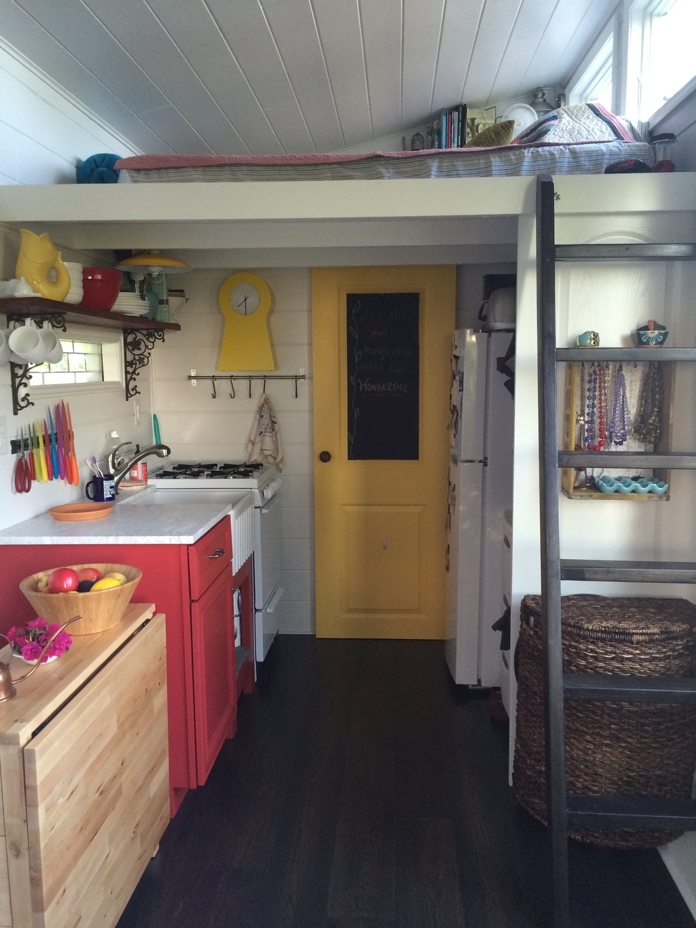 The Kitchen Area Is To The Left, Refrigerator And Closet On The Right  Behind The